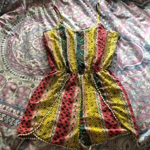 Colorful printed romper with cream colored frills!